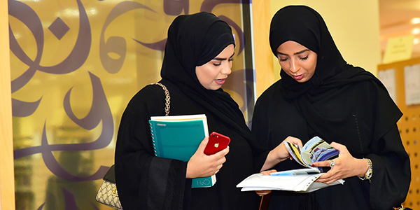 photo of two female students reading
